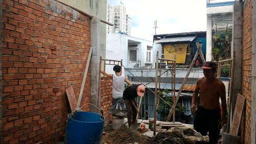 xây tường bao lầu 1, tháo cốt pha sàn lửng